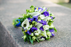 Wedding bouquet with white callas and violet flowers Royalty Free Stock Images