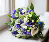 Wedding bouquet with white callas and violet flowers Royalty Free Stock Photos