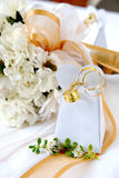 Wedding bouquet white carnations. A floral wedding bouquet, favor and ribbons Royalty Free Stock Image