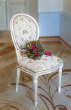 Wedding bouquet on a white chair beautiful Royalty Free Stock Photos