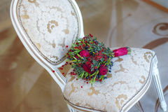 Wedding bouquet on a white chair beautiful Stock Image