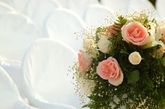 Wedding bouquet and white chairs Stock Image