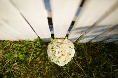 Wedding bouquet on white fense on ceremony place. Top view.Wedding decor Stock Photo