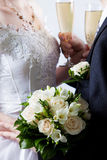Wedding bouquet from white  flowers. In hands at newly married Stock Photography