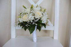 Wedding bouquet with white flowers on  background. Wedding bouquet with white flowers on the white background Royalty Free Stock Photography
