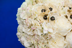 Wedding bouquet of white flowers on a blue background.  Royalty Free Stock Photo