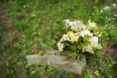 Wedding bouquet of white flowers on the grass. Bridal bouquet Royalty Free Stock Photography