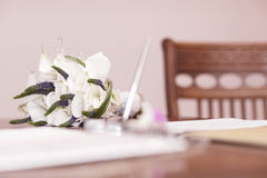 Wedding bouquet of white flowers. Low angle view of a pretty wedding bouquet of white flowers lying on a table top with selective focus and copyspace Stock Images