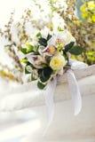 Wedding bouquet of white flowers. Lying on stone Royalty Free Stock Photo