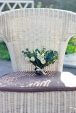 Wedding bouquet of white flowers on the white chair.  Stock Photo