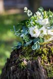 Wedding bouquet of white flowers on the wood stump outdoors , close view.  Royalty Free Stock Photography