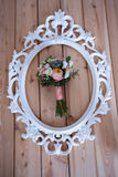 Wedding bouquet of white frame on wooden boards Stock Photos