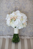 Wedding bouquet of white orchids.  Stock Photos
