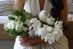 Wedding bouquet with white orchids. Woman holding wedding bouquet with white orchids Royalty Free Stock Photo