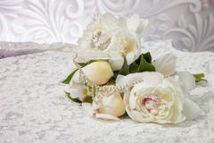 Wedding bouquet of white peonies on the wedding dress Royalty Free Stock Images