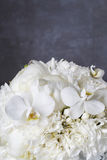 Wedding bouquet with white peonies, orchids and carnations. Party decor Stock Photos