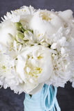 Wedding bouquet with white peonies, orchids and carnations. Party decor Royalty Free Stock Photos