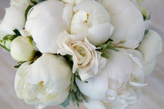 Wedding bouquet of white peonies and ranunculuses. Wedding floristry Stock Photo