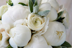 Wedding bouquet of white peonies and ranunculuses. Wedding floristry. Wedding bouquet of white peonies and ranunculuses.Wedding floristry royalty free stock images