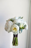 Wedding bouquet of white peonies and ranunculuses. Wedding floristry Royalty Free Stock Photography