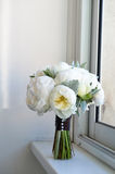 Wedding bouquet of white peonies and ranunculuses. Wedding floristry Stock Images