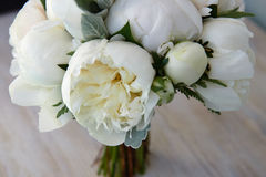 Wedding bouquet of white peonies and ranunculuses. Wedding floristry Royalty Free Stock Photo