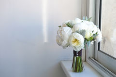 Wedding bouquet of white peonies and ranunculuses. Wedding floristry Stock Photos