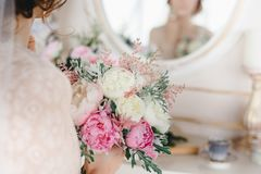 Wedding bouquet with white and pink flowers in the bride`s hands Royalty Free Stock Photos