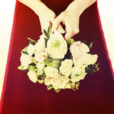 Wedding bouquet from white and pink roses with retro filter effe Royalty Free Stock Images