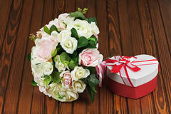 Wedding bouquet from white and pink roses on wooden background. Royalty Free Stock Images
