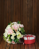 Wedding bouquet from white and pink roses on wooden background. Stock Photo