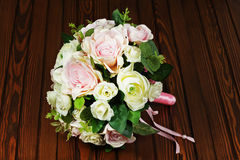 Wedding bouquet from white and pink roses on wooden background. Royalty Free Stock Photography