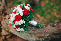 Wedding bouquet with white and red flowers. Wedding details Royalty Free Stock Photos