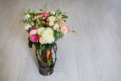 Wedding bouquet of white, red and pink flowers in a vintage vase Royalty Free Stock Photo