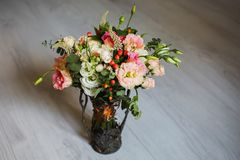 Wedding bouquet of white, red and pink flowers in a vintage vase Stock Image