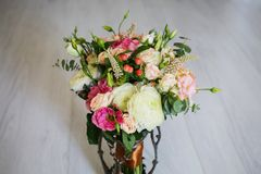 Wedding bouquet of white, red and pink flowers in a vintage vase Stock Photo