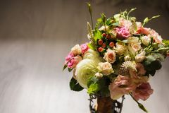 Wedding bouquet of white, red and pink flowers in a vintage vase. Stands on a light background. White and pink roses. Morning bride, copyspace Royalty Free Stock Photo