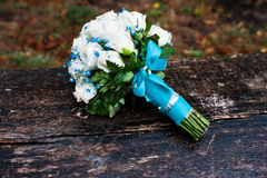 Wedding bouquet with white rose and turquoise ribbon Stock Photography