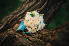 Wedding bouquet of white roses with blue and different colors Stock Photo