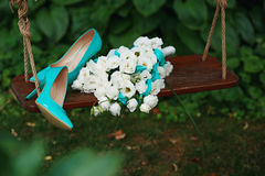 Wedding bouquet of white roses and blue ribbons and blue patent Stock Photos