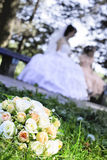 Wedding bouquet with white roses. Laying on grass Royalty Free Stock Photos