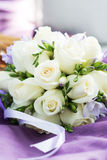 Wedding bouquet with white roses on violet background Stock Photo