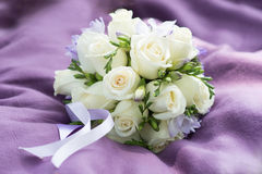 Wedding bouquet with white roses on violet background Stock Images