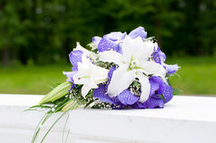 Wedding Bouquet with white and violet flowers. Outdoor Stock Photos