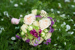 Wedding bouquet with white and violet flowers. Roses, peony Stock Photo