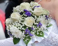 Wedding bouquet with whiteroses. Wedding bouquet with whiter roses in hand of the bride Royalty Free Stock Photo