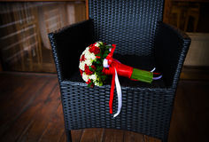 Wedding bouquet in a wicker chair Stock Images