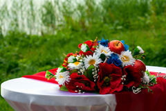 Wedding bouquet of wild flowers. Laying on the table Stock Photo