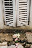 Wedding bouquet on a window Stock Image