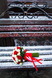 Wedding bouquet on a winter park bench Royalty Free Stock Photos